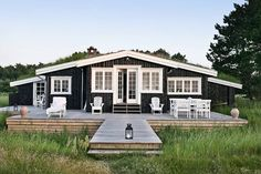 Beach house with sea grass and deck. - The perfect vacation home! Beach Cottage Style, Coastal Cottage, Coastal Living, Cabins And Cottages, Beach Cottages, Navy Blue Houses, Cap Ferret, Beach Bungalows, Timber House