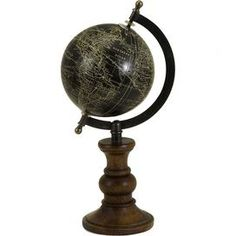 """A perfect addition to your at home office or library, this chic iron and brass globe decor showcases a turned mango wood base for stylish appeal.     Product: Globe Construction Material: Mango wood, paper, iron and brassColor: Brass and blackFeatures:  Old World styleCharming designTurned base  Dimensions: 12"""" H x 5"""" Diameter"""