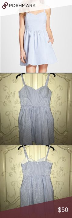 Lilly Pulitzer Christine seersucker dress Get ready for the summer heat, Sorority rush parties, and bonfires with this Lilly Pulitzer seersucker dress. Size 12. Seems small. However HAS POCKETS! Too cute to pass up with a pair of jacks and chunky pearls. Lilly Pulitzer Dresses Midi