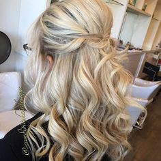 Curly Formal Half Updo With A Bouffant