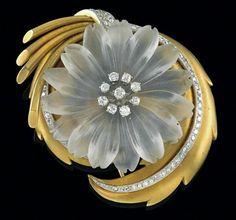 A floral brooch  gold 750, old-cut diamonds, octagonal diamonds, total weight ca. 1,70 ct, platinum settings, matte rock crystal