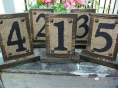 Burlap and natural wood table markers...idea for address numbers.