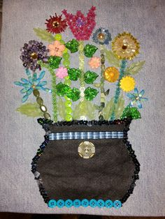 Flowers with buttons, beads and denim.