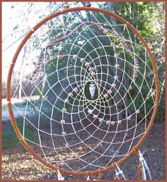 How to make a native american dreamcatcher. Dream catchers are for protecting us from bad dreams. The web catches the dreams and the daylight hits the dream catcher and illuminates the dream.