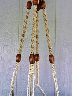 Excited to share the latest addition to my #etsy shop: My shop deals with the handcrafting, and selling of this 46 Inch Pearl and Thatch Macramé Plant Hanger. A Great Christmas Gift Idea! http://etsy.me/2i0nwzV