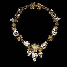 ~1850: Grapes and vine leaves were a recurrent theme, drawing inspiration from the gold jewellery of the ancient world. The fashion for sets of seed pearl jewelry continued through the Victorian era. This example has an intricate and complex construction. Gold wires provide the framework, and the seed pearls are attached with horsehair or silk~