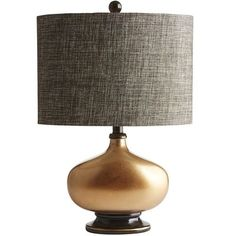 From its broad, turned base to its rounded finial on top, our beautiful Gilded Oval Lamp creates a stable, horizontal volume not often seen. The copper-colored finish contrasts nicely with a linen/poly drum shade that creates an effect at once modern and classic.