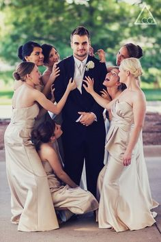 Groom with bridesmaids surrounding. Then do one with the Bride in the middle with grooms surrounding her