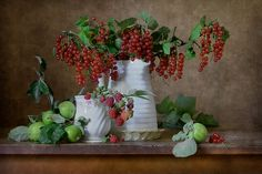 http://nikolay-panov.artistwebsites.com/products/red-currant-and-apples-nikolay-panov-art-print.html Fruits still life with plenty of red currant stems with bright red berries in white pitcher and green fresh apples lying on brown wooden table in countryside in summer