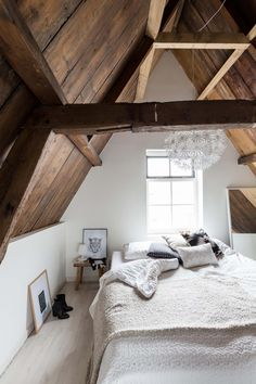 Coziest attic bedroom ever, with beautiful exposed beams.