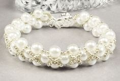 NEW! Think how loved Mom would feel every time she looks at this bracelet on her arm. White Pearls Embellished with Silver Hugs and Kisses Adjustable Mothers Day Bracelet at Pixie Dust Fineries on Etsy