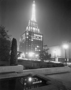 The Richfield Tower as seen from the Flower Street reflecting pool of the Los Angeles Central Library, 1950's