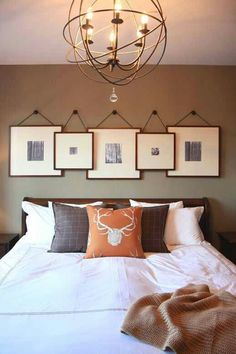 Art above bed. Black or espresso frames with chunky white mats. Black and white nature photos.