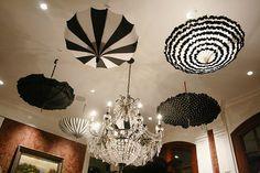 Vintage black and white umbrellas hung upside down