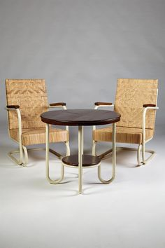 Pair of armchairs and table, anonymous. Sweden. 1930's.
