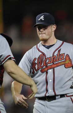 Atlanta Braves catcher Brian McCann (16) 6-3 win with teammate Craig Kimberl #46 of a baseball game at Nationals Park.