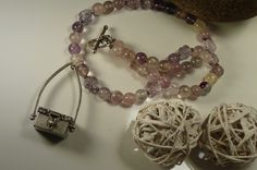 Rainbow fluorite - love its soft hues! & how about that sweet little memory box charm? Romance.