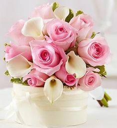 Pink roses and white callas, it is hard to beat this if you want a classic look.