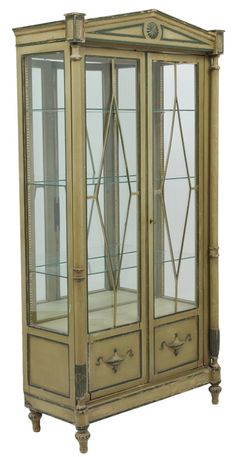 A TALL NEOCLASSICAL STYLE PAINTED VITRINE CABINET Continental, Early 20th Century. Found on auction.mortonkuehnert.com