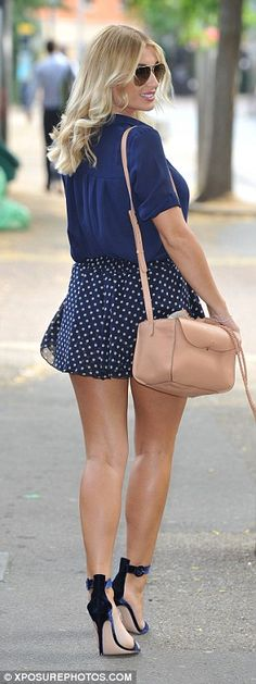 Leggy: The blonde beauty flaunted her incredible figure in a summery mini skirt…