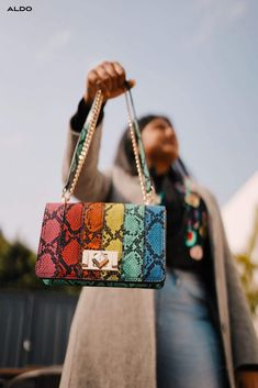 For the girls that prefer a side of glamour with their day, this mid-sized handbag is distinguished by luxuriously exotic-animal embossed stripes and shiny hardware. Shop your new favorite bag in rainbow snake print now at aldoshoes.com.