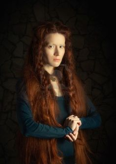 Portrait of young woman with long red hair  Image stylized as old picture Archivio Fotografico