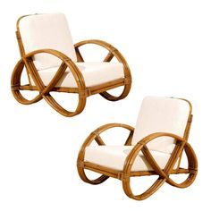 Restored Pair of Vintage Rattan Pretzel Lounge Chairs | From a unique collection of antique and modern lounge chairs at https://www.1stdibs.com/furniture/seating/lounge-chairs/