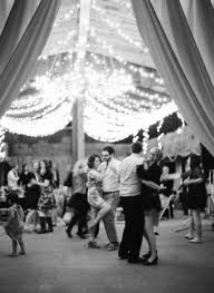 I want the reception in a barn... with hanging lights. :)