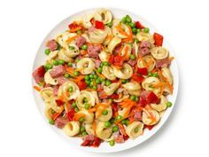 Pasta Salad With Salami, Carrots, Peas and Roasted Red Peppers.