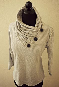 This is an easy DIY to turn a plain v-neck into an interesting cowl collar.  You can use a scarf, fabric, anything that will fit around the neckline.