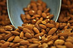 These nuts make the perfect snack food. A quarter cup is right at 200 calories, but you also get 7 grams of protein, nearly 4 grams of fiber and more than half of your daily vitamin E. Those with high cholesterol should take note: Swapping almonds for a similar serving of a carb-heavy snack reduced heart disease risk by 30 percent.