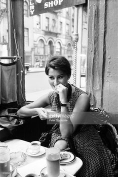 Italian film actress and sex symbol Sophia Loren eats in a cafe, New York, New York, June 1958.