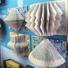 Awesome idea for old books on the wall! I love the patterns that the folded pages create.