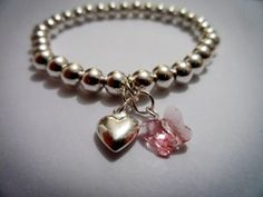 This gorgeous bracelet is a stunning gift and perfectly on trend for Spring / Summer 2013. It is handmade using sterling silver beads and a sterling silver puffed heart. Finished off to perfection with a Swarovski Pink butterfly www.blueapplejewellery.com