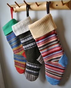 Felted Wool Stockings.  I want to make these for the kids from my  mom's old wool sweaters.