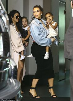 Kim Kardashian holds daughter North West tight as they attend church in Miami after partying at friend's wedding | Daily Mail Online