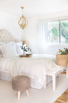 How to Decorate with all white bedding - simple tips sharing how to make white bedding work well in the bedroom with Boll and Branch. Cottage/Farmhouse style