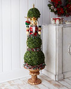Nutcracker Christmas Topiary at Horchow. Wow, very pricey, wonder if I could make this? Noticed Marshall's, TJ, and Home goods all had a few giant nutcrackers could use as basis.