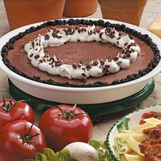 "Frosty Chocolate Pie Recipe -""This chilled treat takes me back to my childhood because it tastes like a Fudgesicle,"" shares Maria Regakis. THe Somerville, Massachusetts reader turns sandwich cookies, chocolate pudding and vanilla ice cream into a dessert guaranteed to satisfy the kid in everyone."