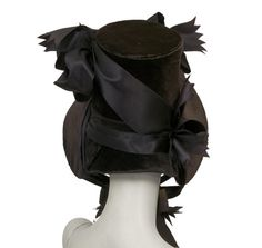 Bonnet    Place of origin:  England, Great Britain (made)    Date:  about 1830 (made)    Artist/Maker:  Unknown (production)    Materials and Techniques:  straw, velvet, silk    Credit Line:  Given by Mrs George Atkinson and Mrs M F Davey    Museum number:  T.202-1958 #millinery #bonnets #judithm