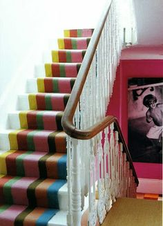 Stairway with multi color runner.