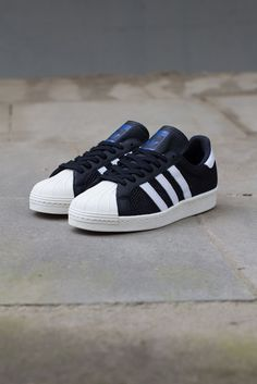 Ready for warm weather, adidas Originals has fitted the Superstar in a mesh heavy build, cut with leather. This black and white colorway is now availab Basket Sneakers, Cute Sneakers, Dress With Sneakers, Shoes Sneakers, New Shoes, Men's Shoes, All Star, Baskets, Adidas Fashion