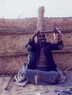 Southern Iraq:  man spinning wool