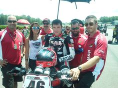 Shane Narbonne on the grid with M.O.B. Racing at Barber Motorsports Park for the AMA Pro Road Racing Vance & Hines Harley-Davidson XR1200 Series with their Veterans Empowered Through Motorsports crew members Stephen and Dallas.