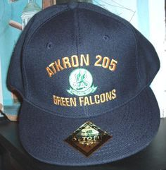 26e066d9eec ATKRON 205 GREEN FALCON This is a custom made FITTED ball cap with ball cap  back embroidery. This ball cap sells for  59.50 ea.