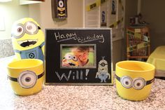 Chalkboard frame and ceramic yellow planters from the 99 cent store with printout goggles taped on.