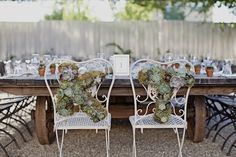 a fun way to denote your special bride and groom chairs, AND a keepsake for your home after the wedding!