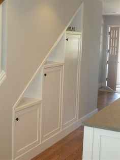 under stair storage - like the display shelves above the cabinet doors