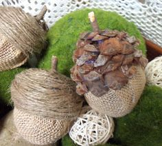 Acorns made from plastic easter eggs, burlap and pinecones. How cute!
