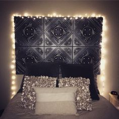 DIY headboard with faux tin tiles!! 20x20inch foam tiles painted any color. Very EASY assembly.. just attach to wall with adhesive strips and you're done !:)